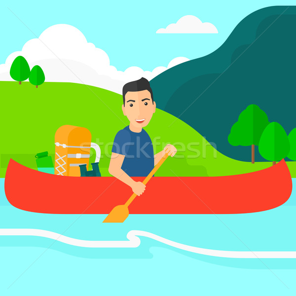 Man canoeing on the river. Stock photo © RAStudio