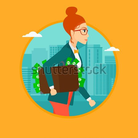 Business woman carrying briefcase full of money. Stock photo © RAStudio