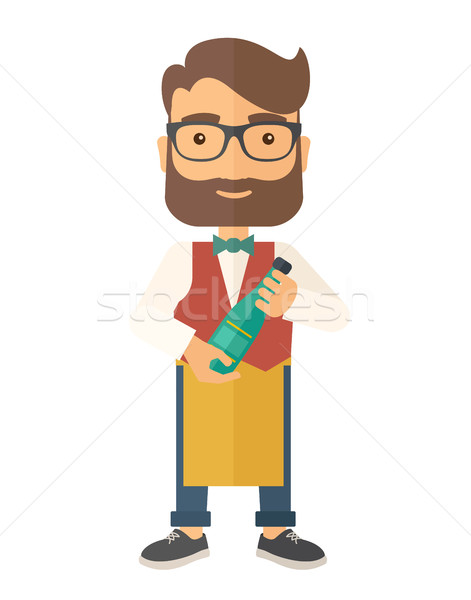 Wine maker holding a bottle of wine. Stock photo © RAStudio