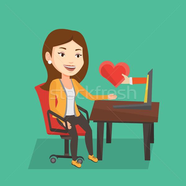 Mulher jovem namoro on-line usando laptop mulher caucasiano Foto stock © RAStudio