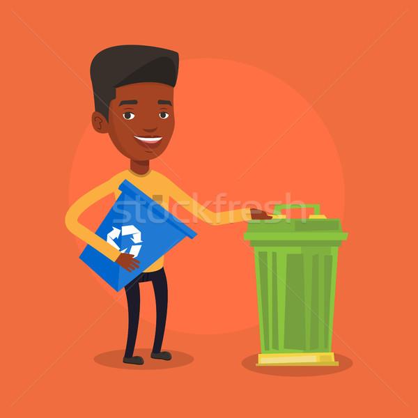 Férfi újrahasznosít tároló szemeteskuka fiatal hordoz Stock fotó © RAStudio