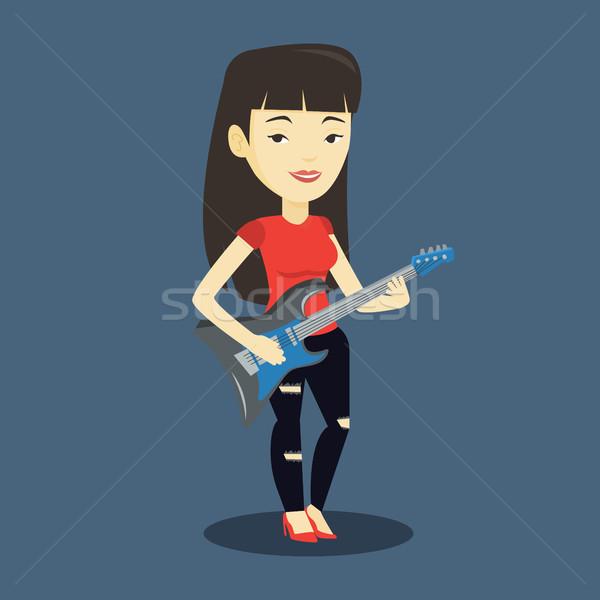 Nő játszik elektromos gitár fiatal ázsiai zenész Stock fotó © RAStudio