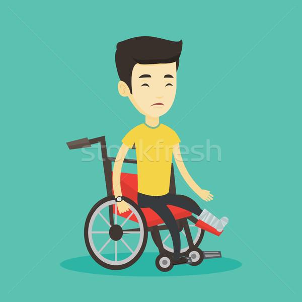 Stock photo: Man with broken leg sitting in wheelchair.