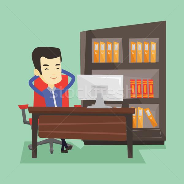 Satisfecho hombre de negocios relajante oficina sesión lugar de trabajo Foto stock © RAStudio
