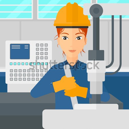 Woman working with industrial equipment. Stock photo © RAStudio