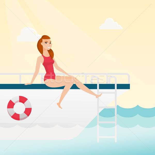 Young caucasian woman tanning on the yacht. Stock photo © RAStudio