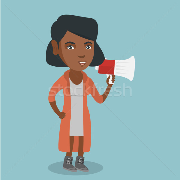 African woman promoter speaking into megaphone. Stock photo © RAStudio