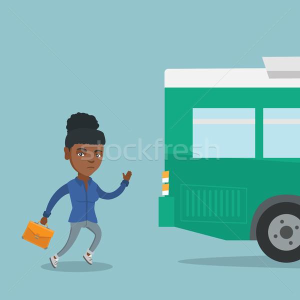 African latecomer woman running for the bus. Stock photo © RAStudio
