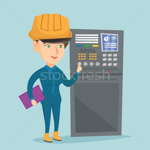 Industrial engineer working on control panel. Stock photo © RAStudio