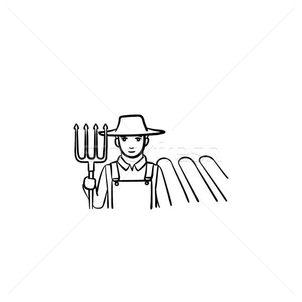 Farmer with fork hand drawn sketch icon. Stock photo © RAStudio
