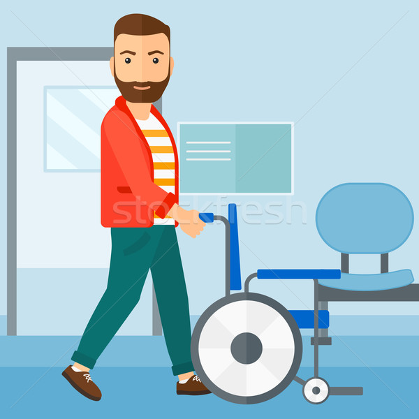 Man pushing wheelchair. Stock photo © RAStudio