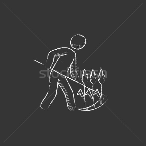 Man mowing grass with scythe. Drawn in chalk icon. Stock photo © RAStudio