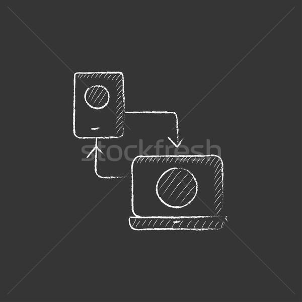 Synchronization smartphone with laptop. Drawn in chalk icon. Stock photo © RAStudio