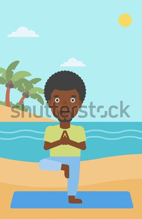 Stock photo: Man meditating in lotus pose.