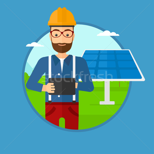 Male worker of solar power plant. Stock photo © RAStudio