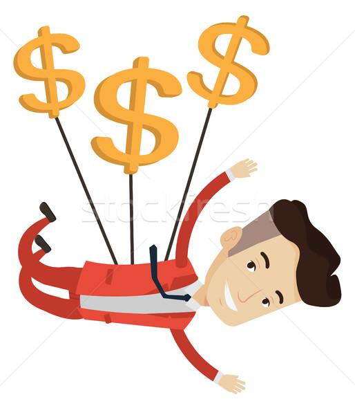 Businessman flying with dollar signs. Stock photo © RAStudio