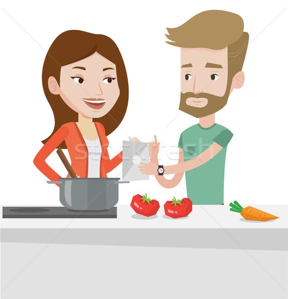 Couple cooking healthy vegetable meal. Stock photo © RAStudio