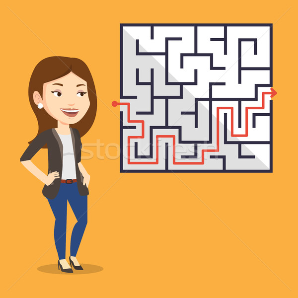 Business woman looking at labyrinth with solution Stock photo © RAStudio