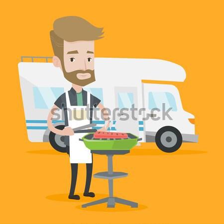 Man having barbecue in front of camper van. Stock photo © RAStudio