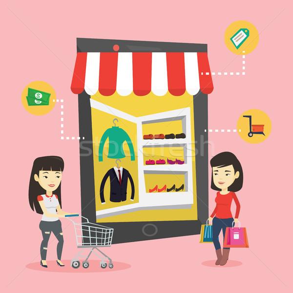 две женщины торговых онлайн молодые азиатских Сток-фото © RAStudio
