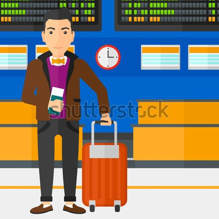 Man with suitcase and ticket at the airport. Stock photo © RAStudio