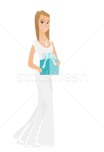 Woman in white bridal dress holding gift box. Stock photo © RAStudio