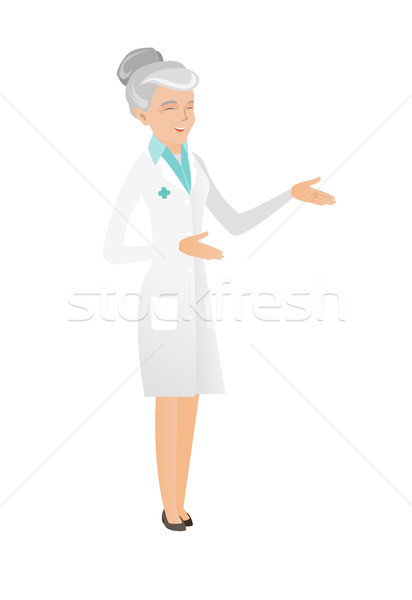 Senior caucasian happy doctor gesticulating. Stock photo © RAStudio
