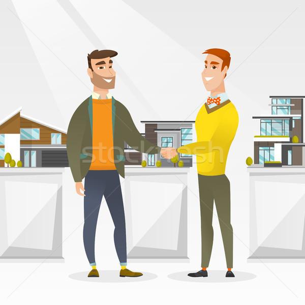 Accordo agente immobiliare acquirente giovani agente immobiliare Foto d'archivio © RAStudio