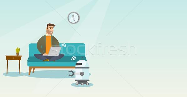 Jovem caucasiano engenheiro programação robô doméstico Foto stock © RAStudio