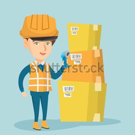 Entrepôt travailleur Barcode boîte cases scanner Photo stock © RAStudio