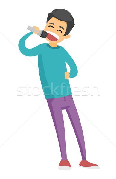 Jonge kaukasisch blanke man zingen karaoke gelukkig Stockfoto © RAStudio