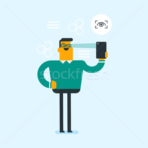 Man using iris scanner to unlock a mobile phone. Stock photo © RAStudio