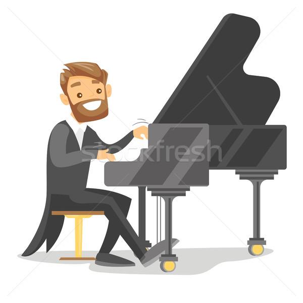 Fiatal kaukázusi fehér férfi játszik zongora fehér Stock fotó © RAStudio