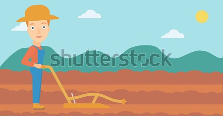 Farmer on the field with plough. Stock photo © RAStudio