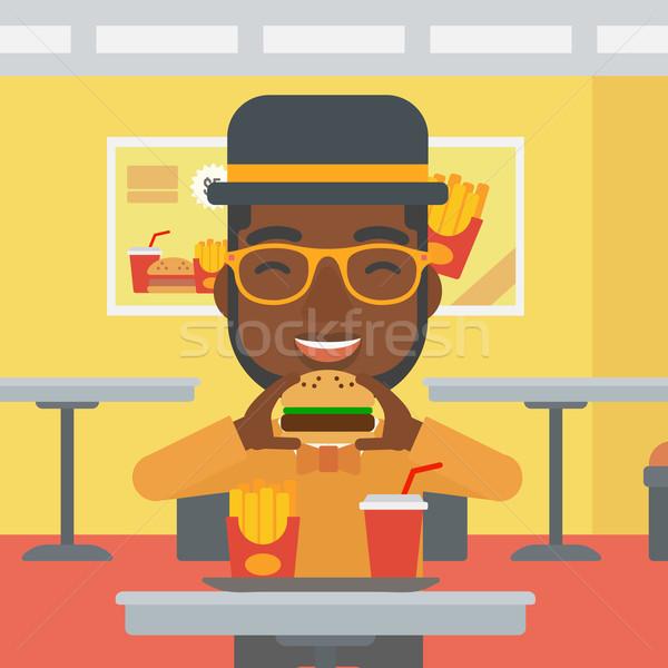 Stockfoto: Man · eten · hamburger · cafe · vector · ontwerp