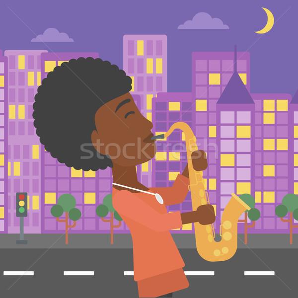 Kobieta gry saksofon muzyk noc miasta Zdjęcia stock © RAStudio
