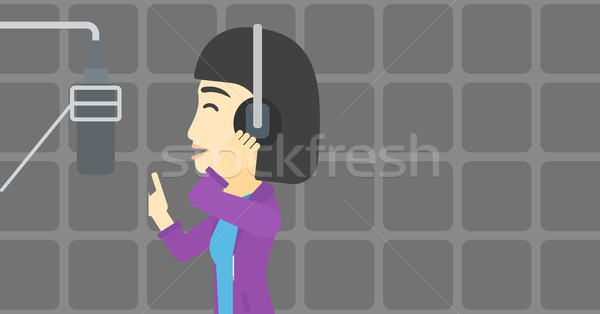 Piosenkarka piosenka asian młoda kobieta słuchawki śpiewu Zdjęcia stock © RAStudio