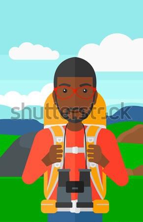 Wesoły podróżnik plecak człowiek spaceru góry Zdjęcia stock © RAStudio