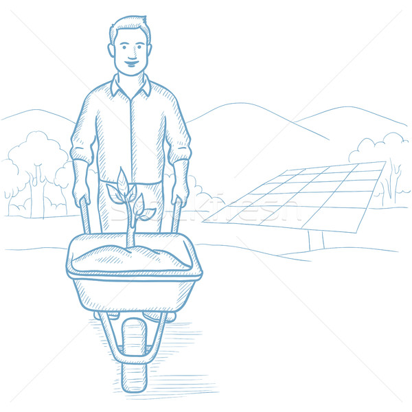 Worker of solar power plant with sprout in cart. Stock photo © RAStudio