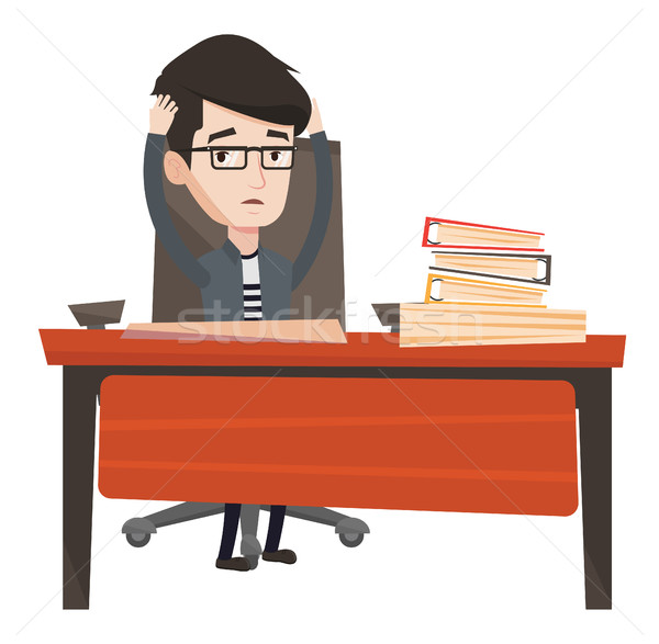 Stressful employee sitting at workplace. Stock photo © RAStudio
