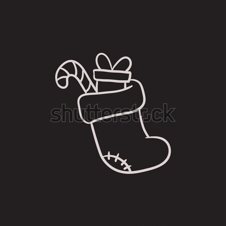 Christmas boot with gift and candy sketch icon. Stock photo © RAStudio