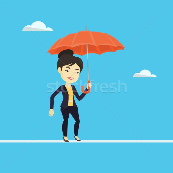 деловой женщины туго натянутый канат рискованный ходьбе зонтик Сток-фото © RAStudio
