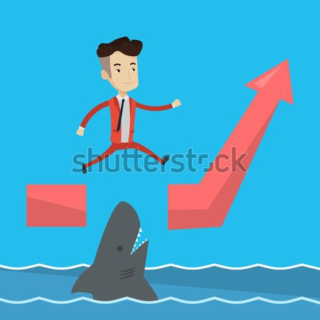 Risky businessman jumping over ocean with shark. Stock photo © RAStudio