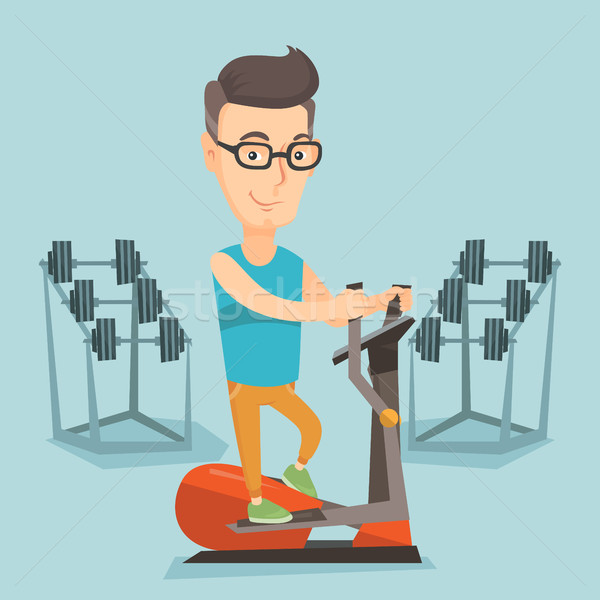 Man exercising on elliptical trainer. Stock photo © RAStudio