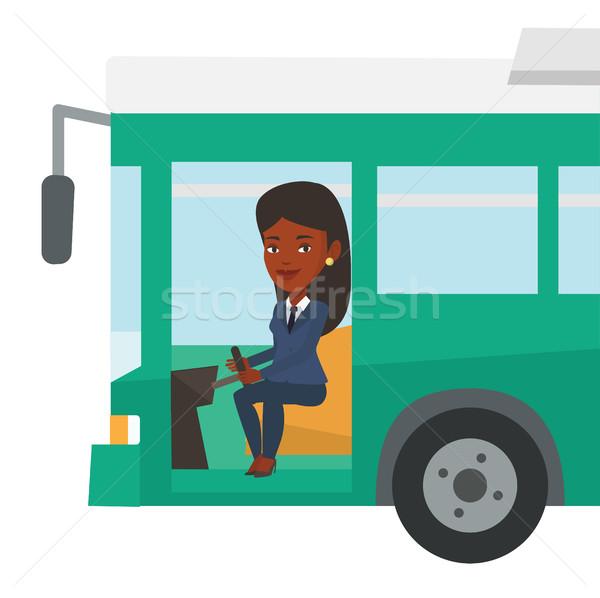 African bus driver sitting at steering wheel. Stock photo © RAStudio