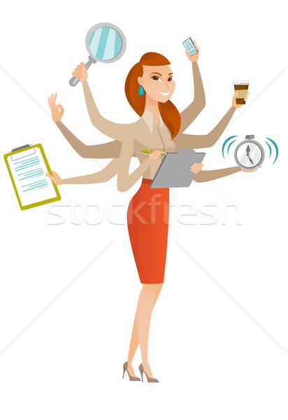 Donna d'affari multitasking giovani molti gambe mani Foto d'archivio © RAStudio