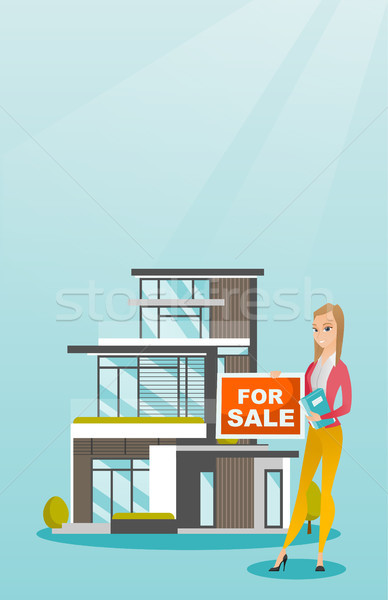Young caucasian broker offering the house. Stock photo © RAStudio