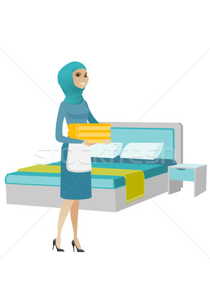 Muslim housekeeping maid with stack of linen. Stock photo © RAStudio