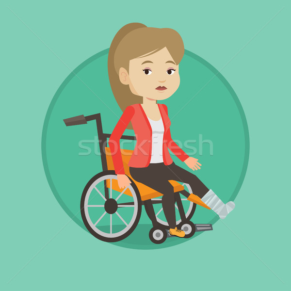 Stock photo: Woman with broken leg sitting in wheelchair.