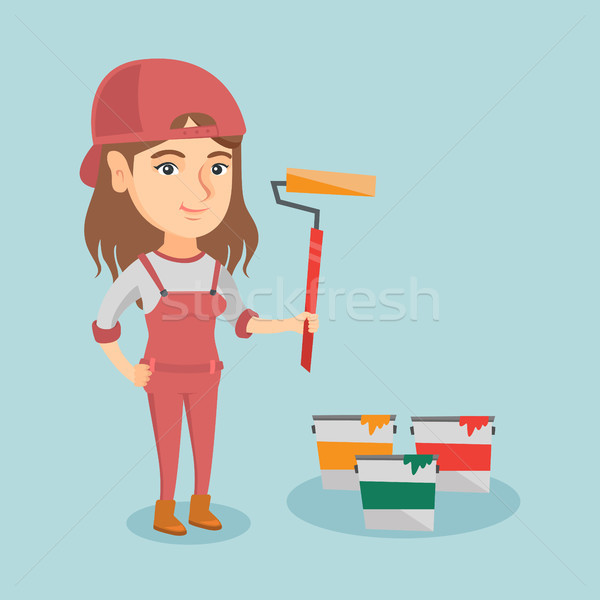 Young caucasian painter holding a paint roller. Stock photo © RAStudio